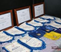 Flamula, lenço, certificado e medalha